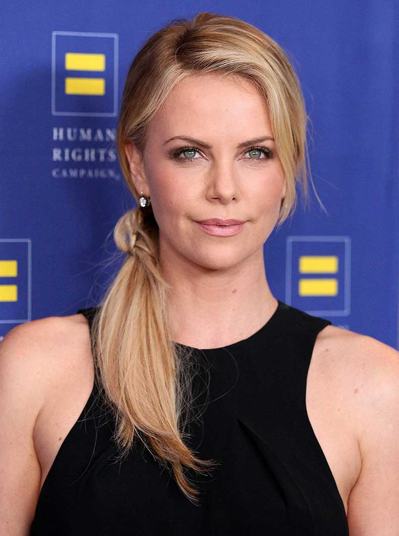 Charlize-kept-her-hair-fun-casual-texturized-side-ponytail