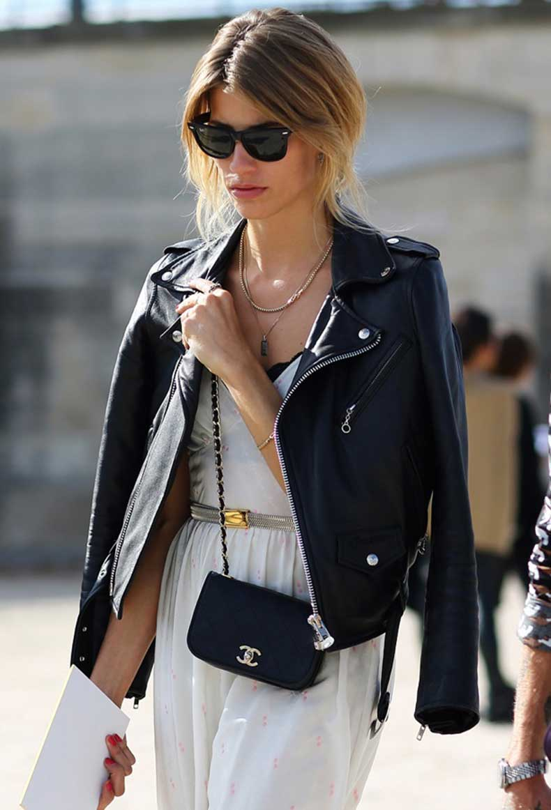 street-style-leather-moto-jacket-over-the-shoulders-paris-fashion-week-ray-ban-wayfarer-sunglasses-layered-necklaces-simple-white-dress-peek-a-boo-bra-metallic-waist-thin-belt-small-chai