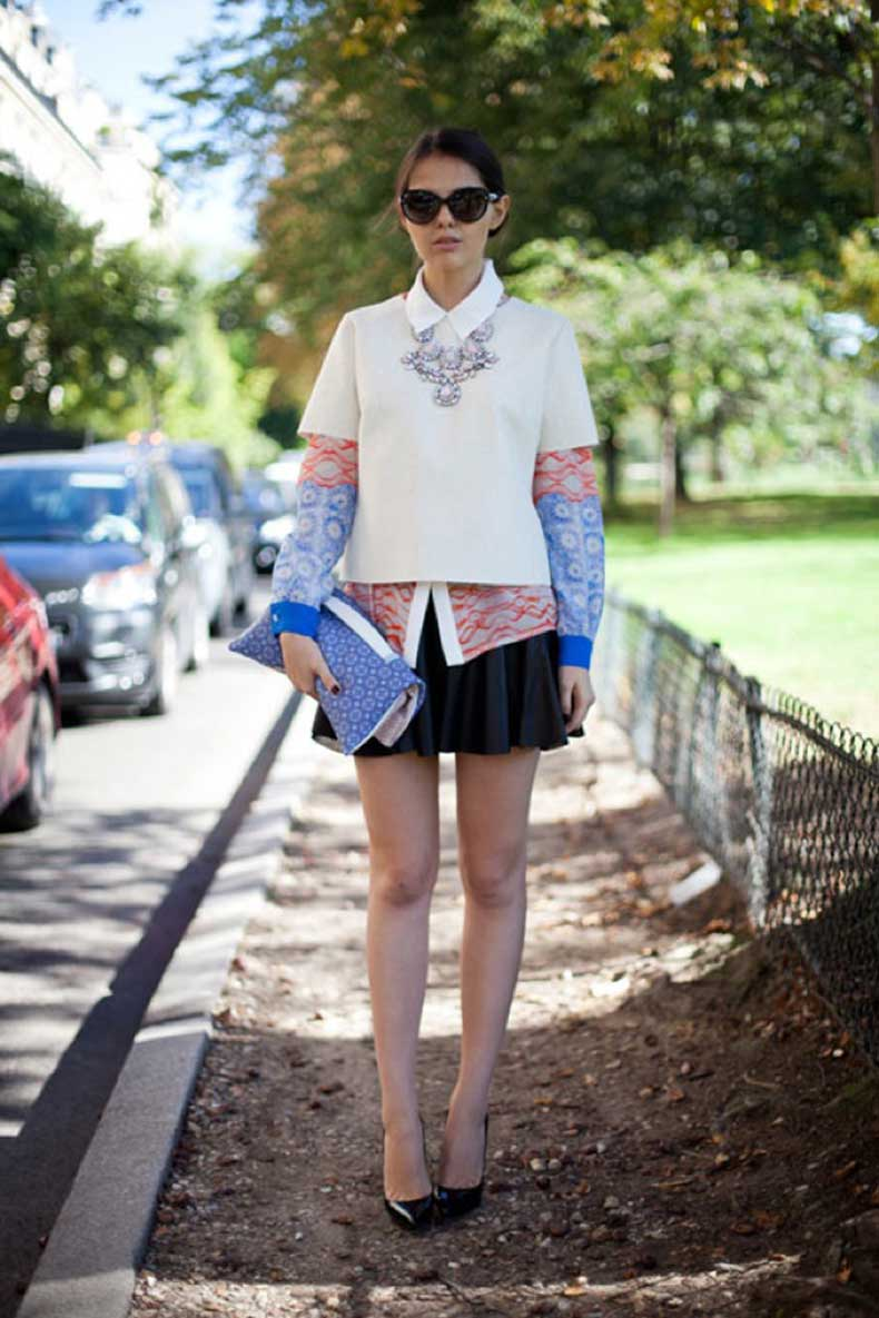 street-style-white-collar-shirt-fashion-week-print-color-block-collared-shirt-harpers-bazaar-layered-sheel-top-embellished-chunky-necklace-leather-aline-skater-skirt-floder-over-clutch-b