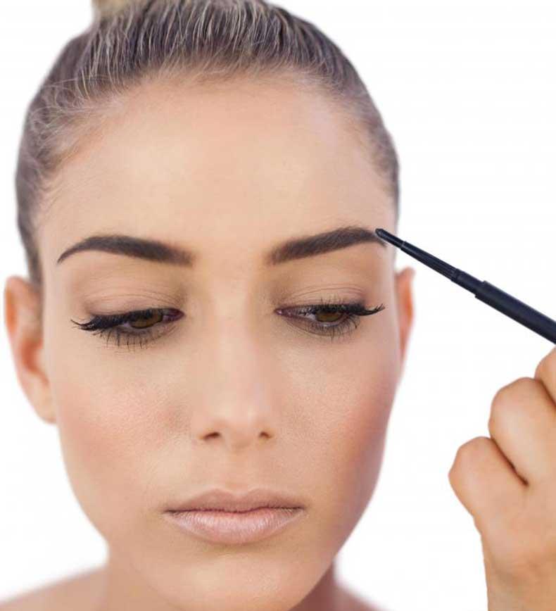 woman-using-makeup-to-darken-eyebrow