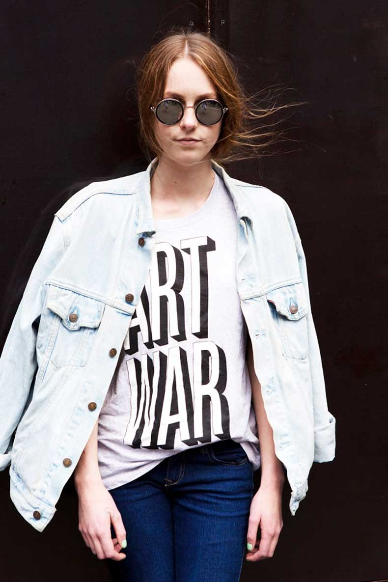 STREET-STYLE-ROUND-SUNGLASSES-PRINT-LETTERS-WORDS-VINTAGE-TEE-TSHIRT-LIGHT-WASH-DENIM-JEAN-JACKET-PARIS-FASHION-WEEK-VIA-VOGUE-UK