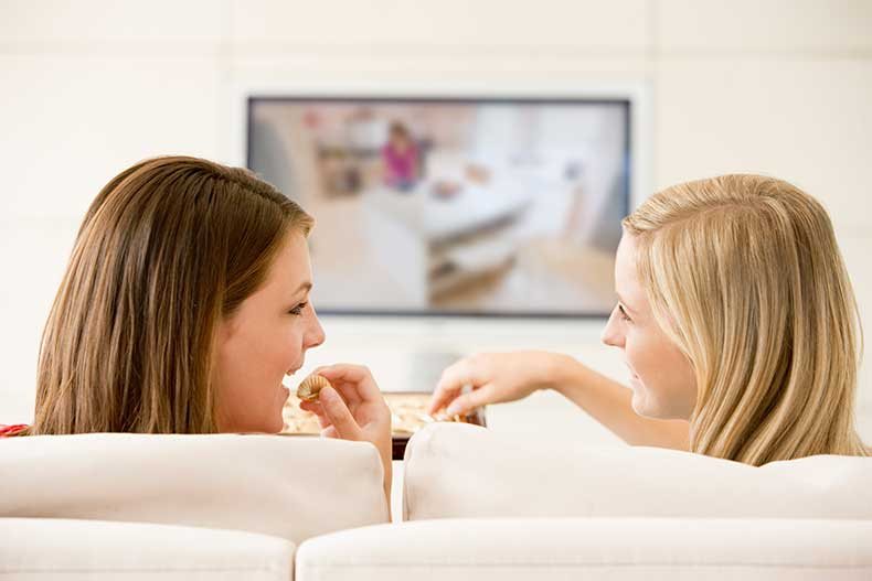 Two-Women-In-Living-Room-Watch