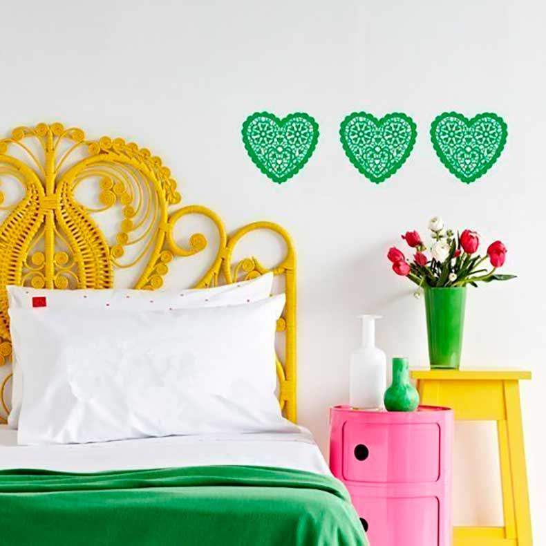 brightly-colored-bedside-with-a-yellow-headboard