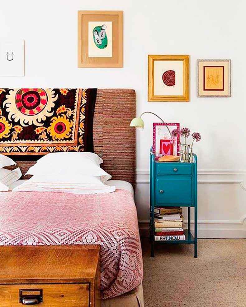 colorful-bedroom-with-a-patterned-headboard-and-off-center-art