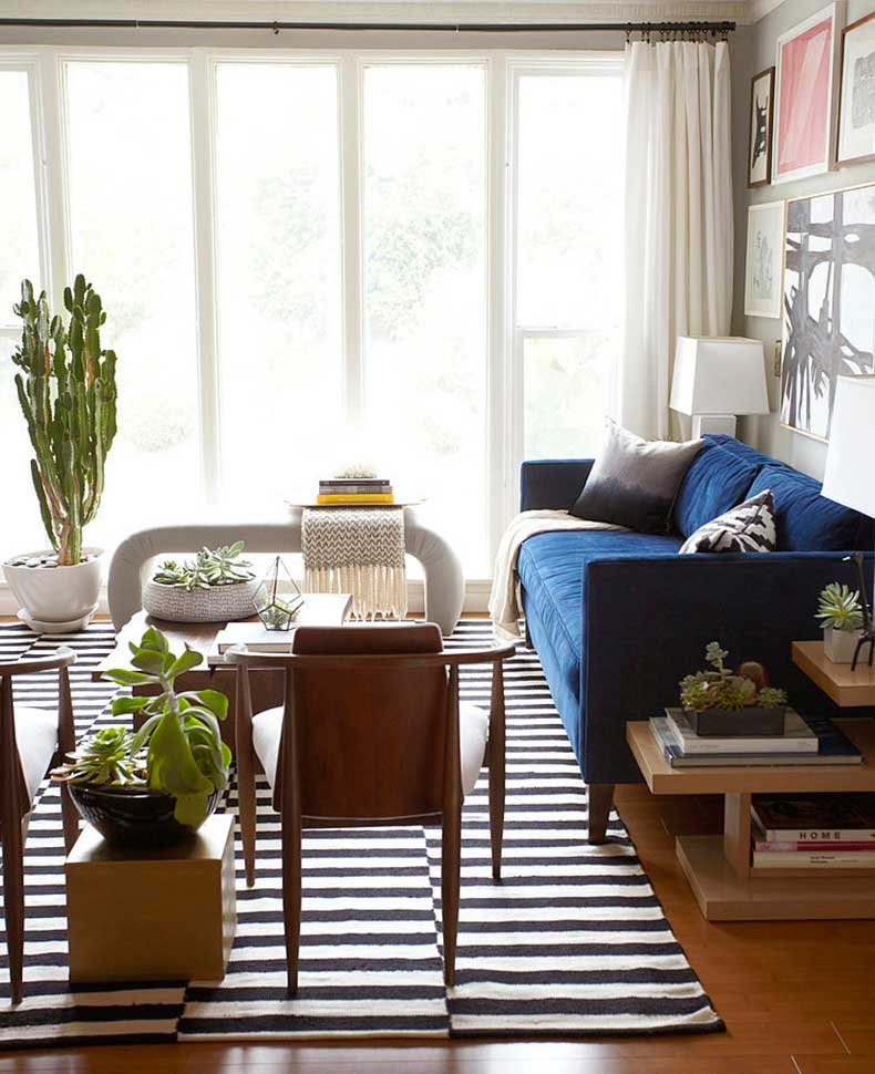 Although-apartment-comprised-mostly-neutrals-blue-sofa