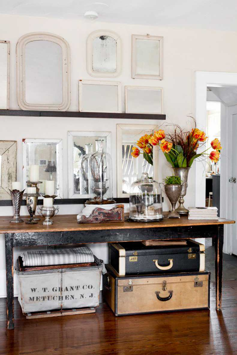 Joanna-Madden-Console-Table-Rikki-Snyder-Photography-Style-Me-Pretty-Living-Home-Tour-Vintage-Mirrors-Suitcases-600x899