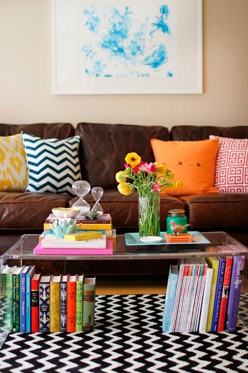 books-under-a-clear-coffee-table