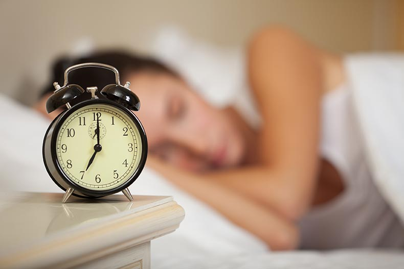 sleeping-woman-and-alarm-clock-bedroom-home