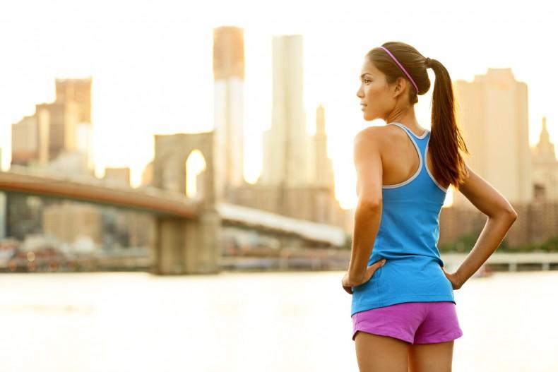 Fitness woman runner relaxing after city running