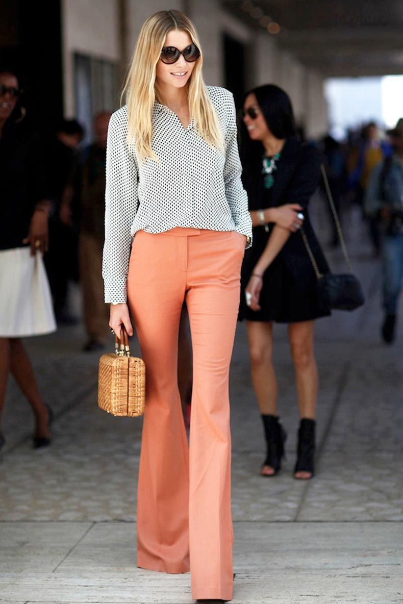 Le-Fashion-Blog-New-York-Street-Style-Jessica-Hart-Print-Shirt-Basket-Bag-Peach-Flares-Orange-Flared-Pants-Bell-Bottoms-Via-Vanity-Fair