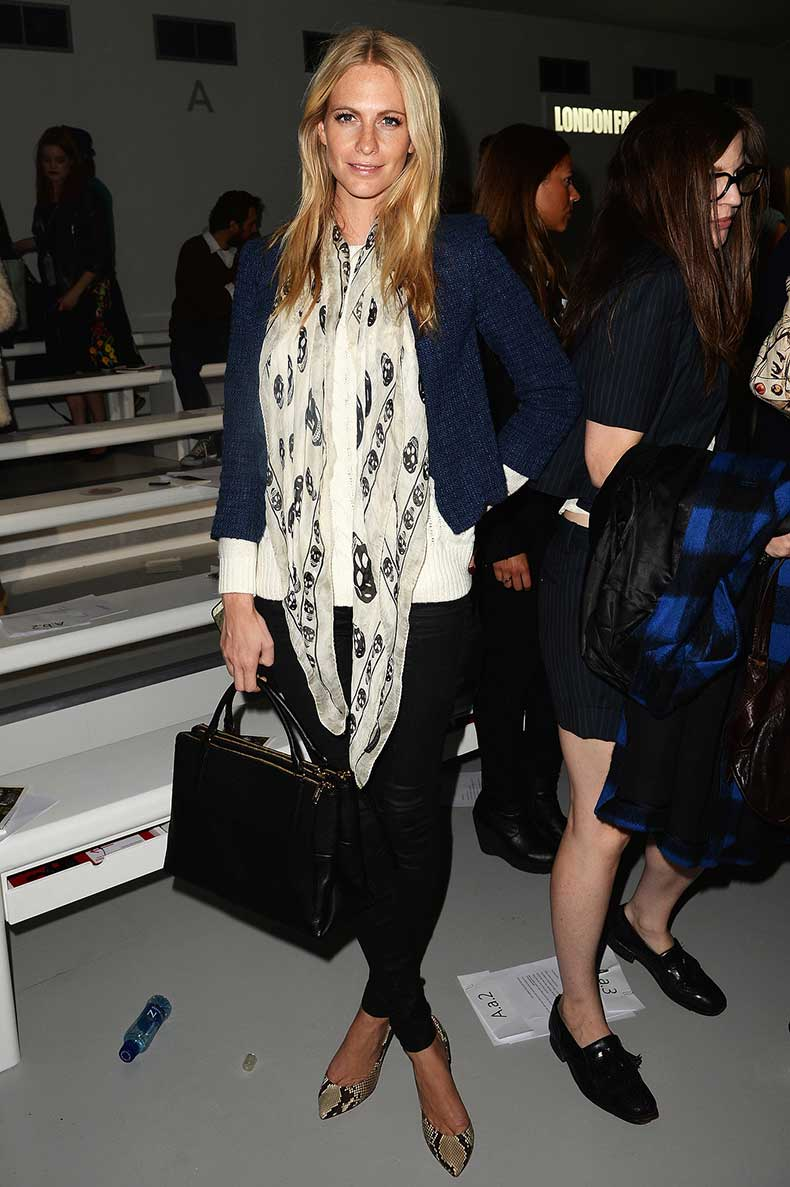 Poppy-Delevingne-accessorized-outfit-making-scarf-while