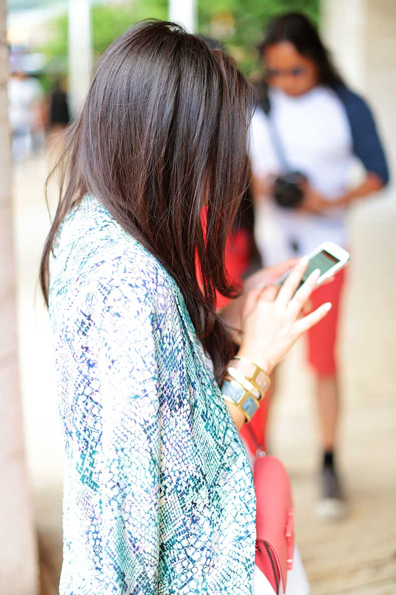 Girl-Texting-on-Cell-Phone-MBFW-Street-Style-New-York-Lincoln-Center-Brahmin-Bracelets