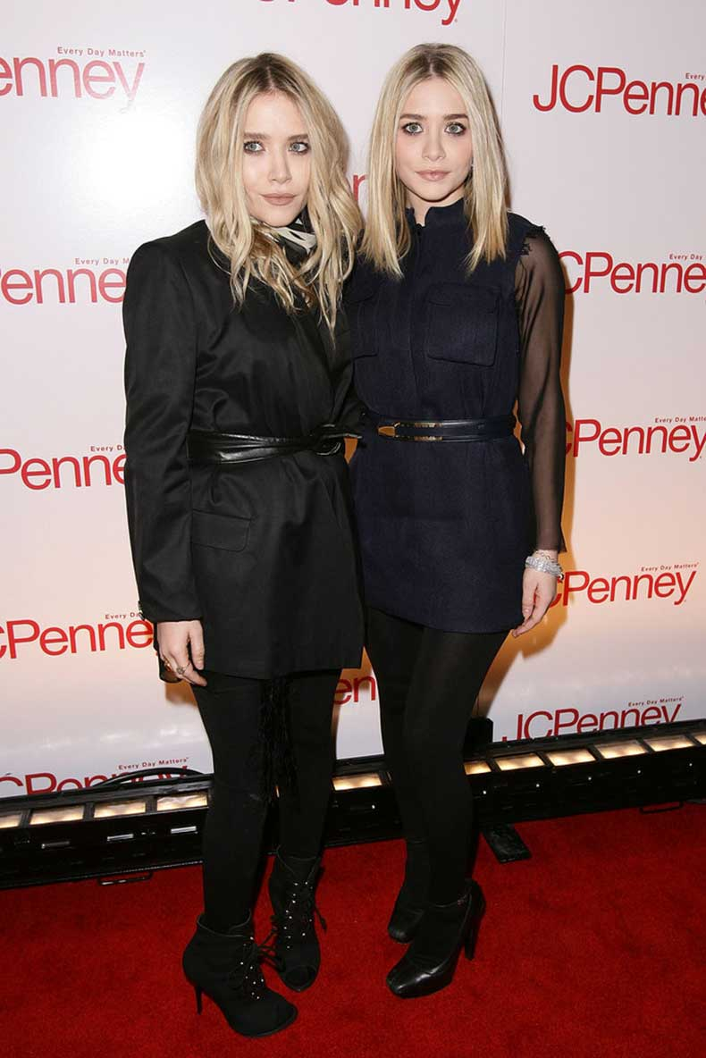 Twinning-combo-blond-duo-posed-cinched-dresses-black