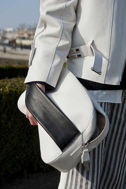 oversize-white-clutch-featured-bold-black-strap-maximum