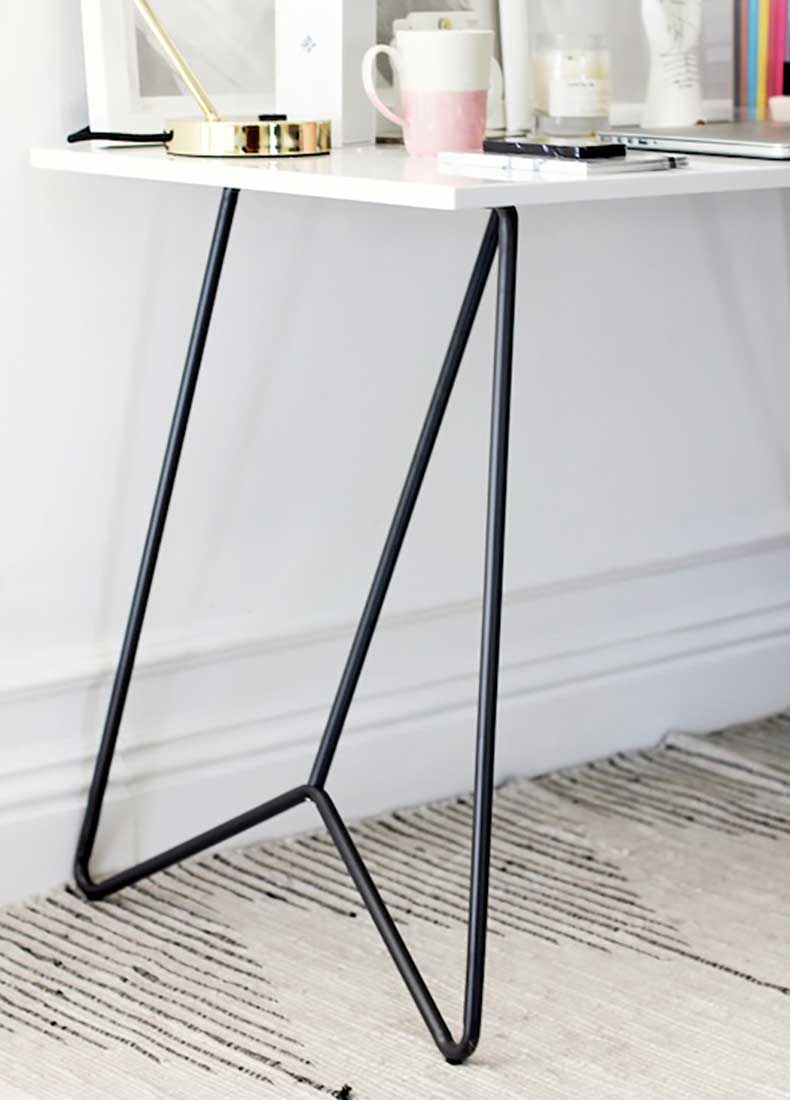 Le-Fashion-Blog-Stylish-Whimsical-Work-Space-Urban-Outfitters-Architectural-White-Modern-Desk-Black-Metal-Legs-Striped-Rug