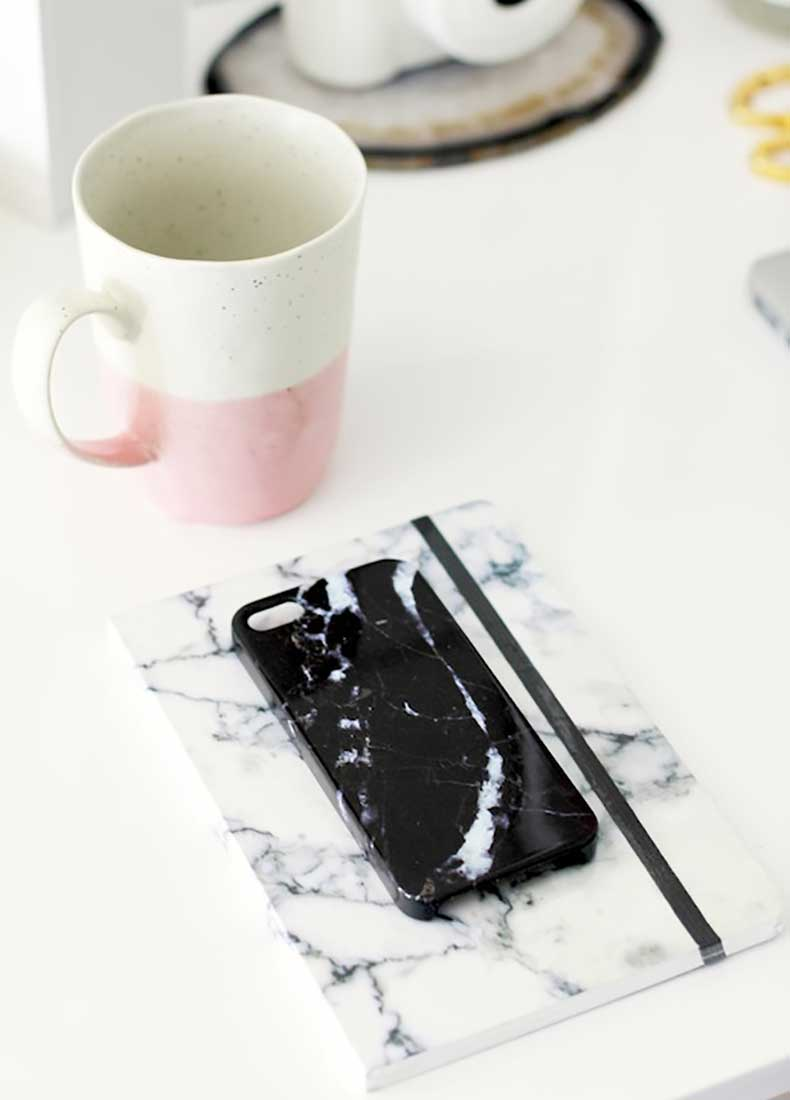 Le-Fashion-Blog-Stylish-Whimsical-Work-Space-Urban-Outfitters-Black-Marble-Phone-Case-White-Marbled-Notebook-Pink-Ceramic-Mug