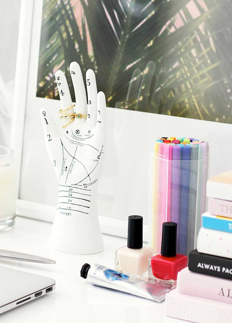 Le-Fashion-Blog-Stylish-Whimsical-Work-Space-Urban-Outfitters-Hand-Jewelry-Ring-Holder-Nude-And-Red-Nail-Polish-Hand-Lotion-Office-Decor