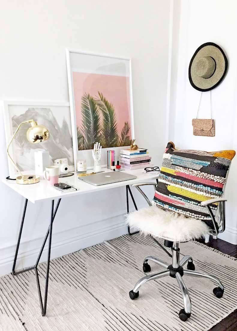 Le-Fashion-Blog-Stylish-Whimsical-Work-Space-Urban-Outfitters-Striped-Rug-White-Chair-Modern-Desk-Palm-Print-Colorful-Pillow-Gold-Lamp-Home-Decor