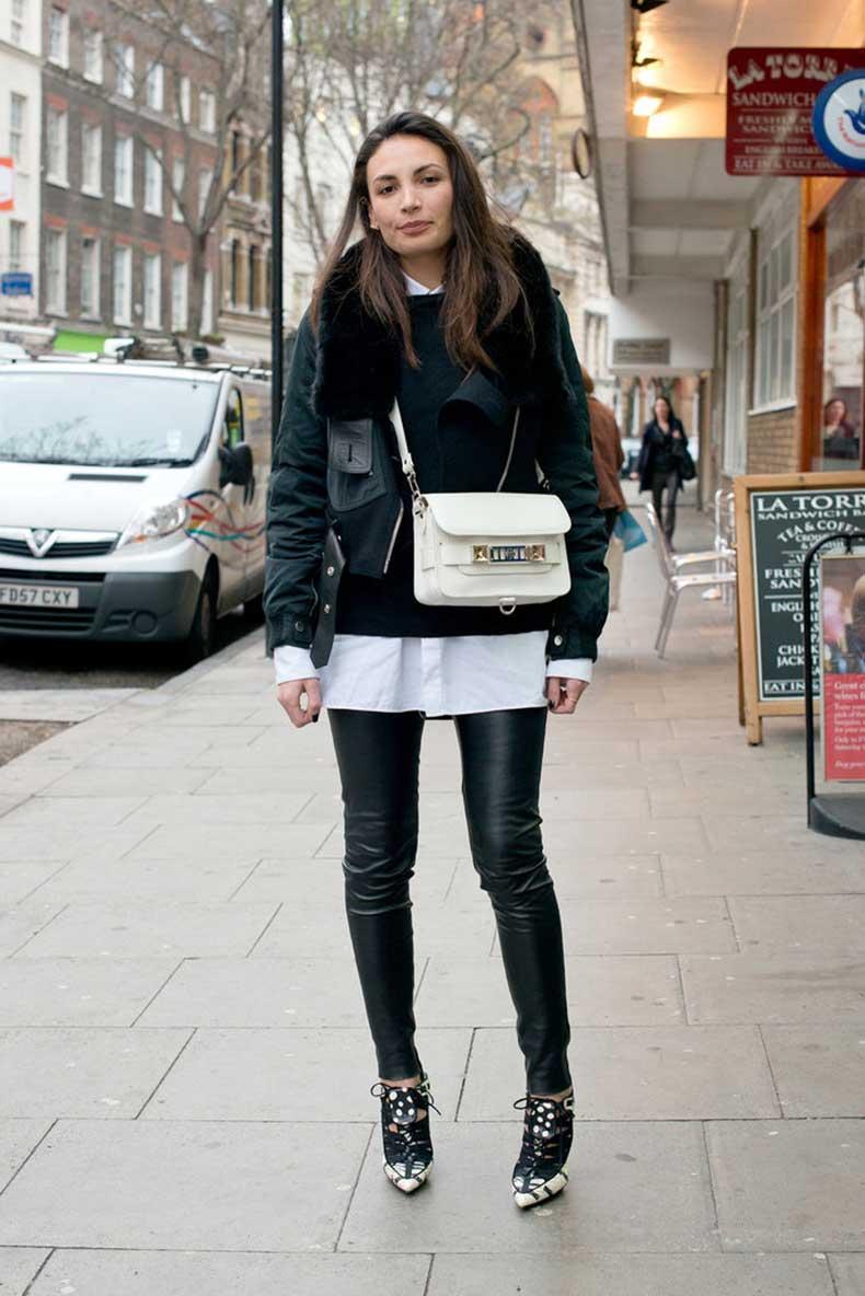 sleek-Proenza-bag-popped-against-slick-black-leather