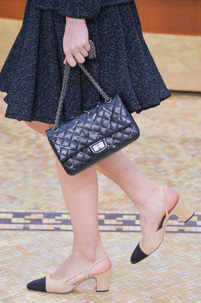 She-also-popularized-her-eponymous-two-toned-shoes-gold-chained-handbags