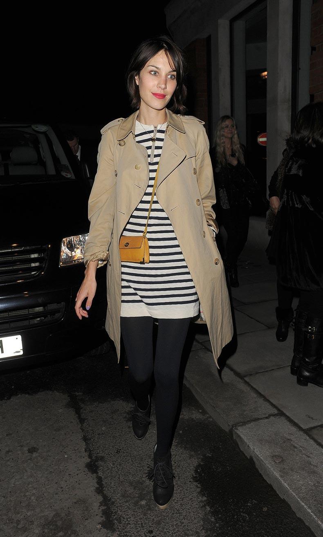 alexa_chung_striped_dress_tan_leather_satchel_black_tights_pink_lipstick_khaki_trench