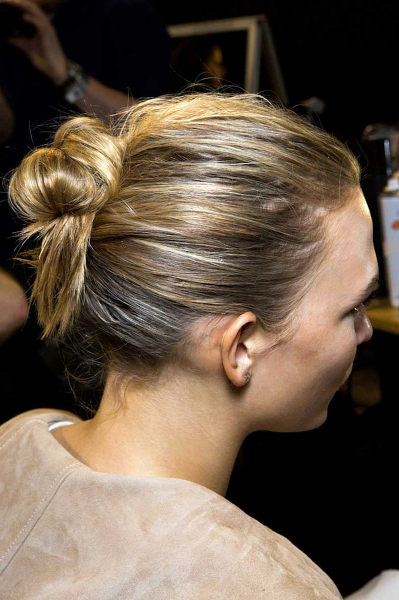 1-Le-Fashion-Blog-Backstage-Beauty-Hair-Inspiration-Twisted-Messy-Buns-Isabel-Marant-FW-2015-Karlie-Kloss-Up-Do-Top-Knot
