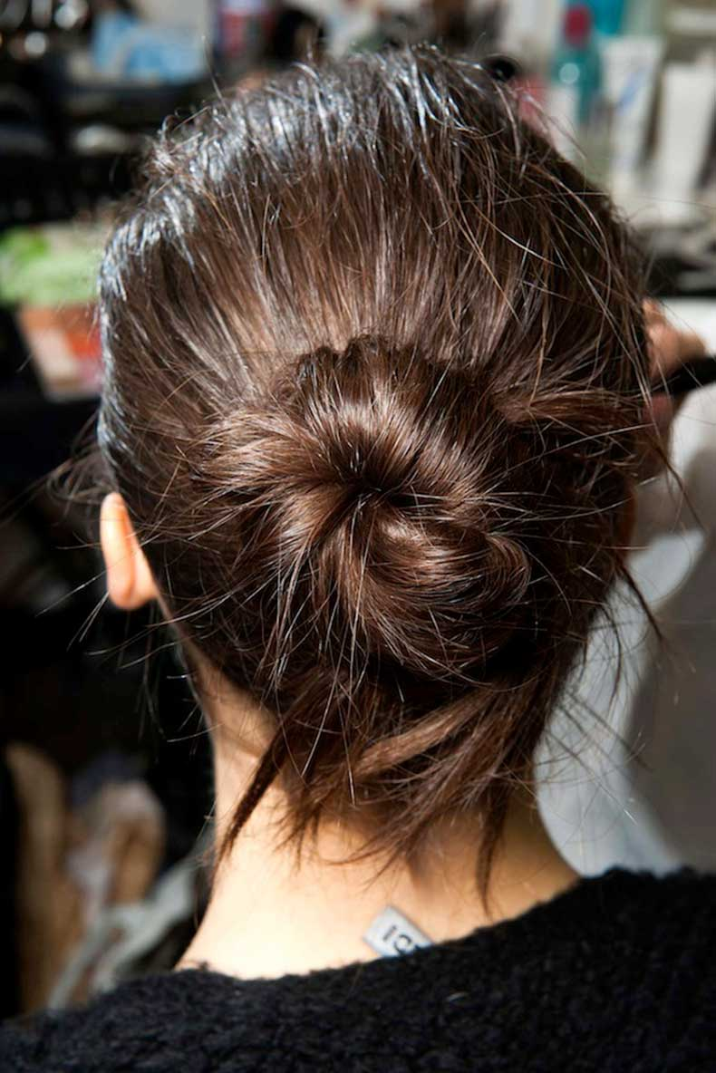 2-Le-Fashion-Blog-Backstage-Beauty-Hair-Inspiration-Twisted-Messy-Buns-Isabel-Marant-FW-2015-Brunette-Up-Do-Top-Knot