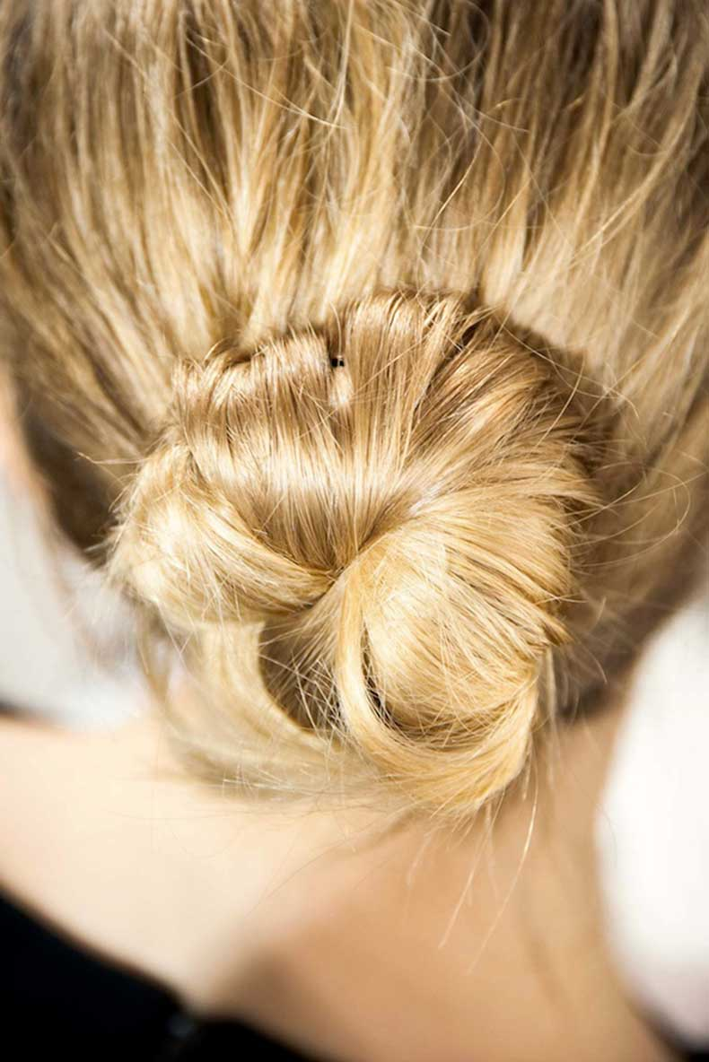 8-Le-Fashion-Blog-Backstage-Beauty-Hair-Inspiration-Twisted-Messy-Buns-Isabel-Marant-FW-2015-Up-Do-Top-Knot-Close-Up