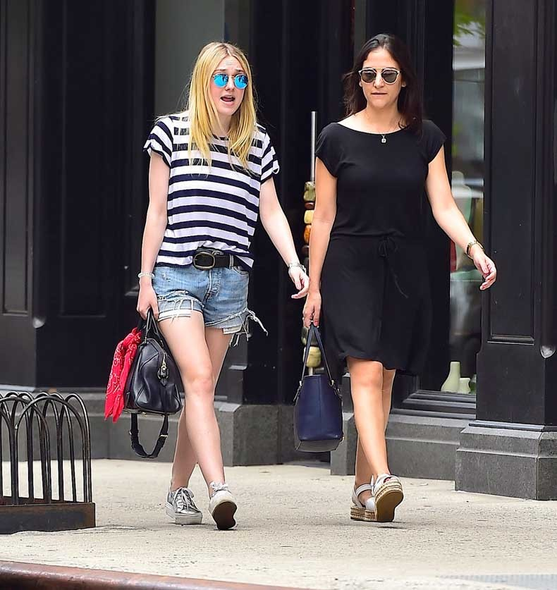 Dakota-worked-her-cutoffs-go--striped-t-shirt-while-out