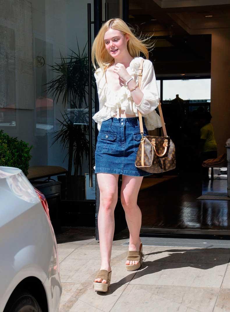 Elle-paired-her-denim-mini-cream-ruffled-blouse-Louis