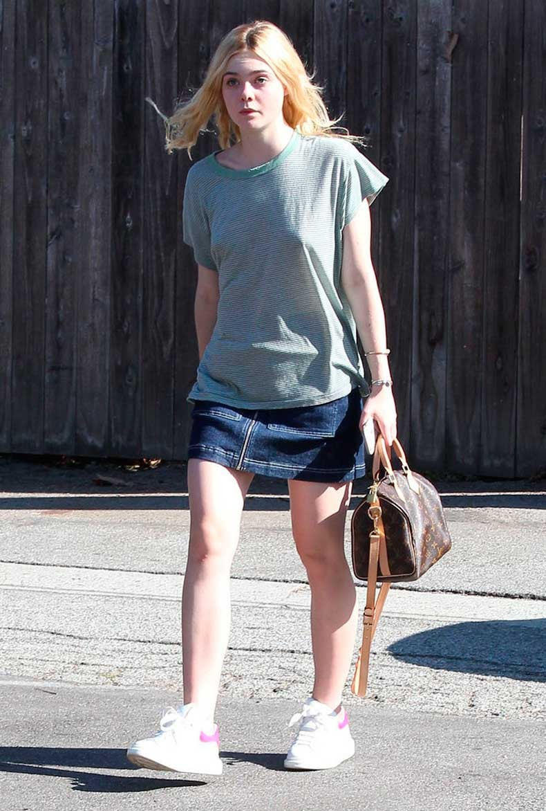 Elle-went-high-low-look-covering-top-her-skirt