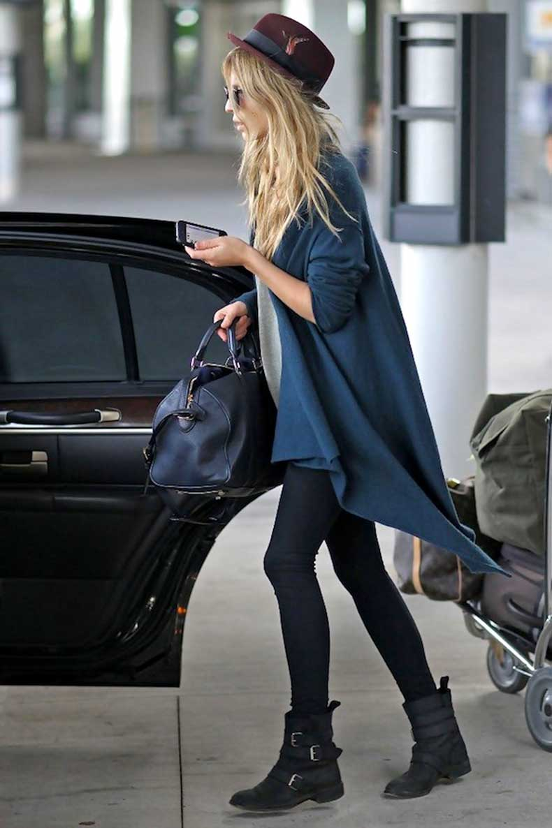 Le-Fashion-Blog-Airport-Look-Clemence-Poesy-Parisian-Casual-Feather-Red-Hat-Drape-Cardigan-Leggings-Buckle-Moto-Boots