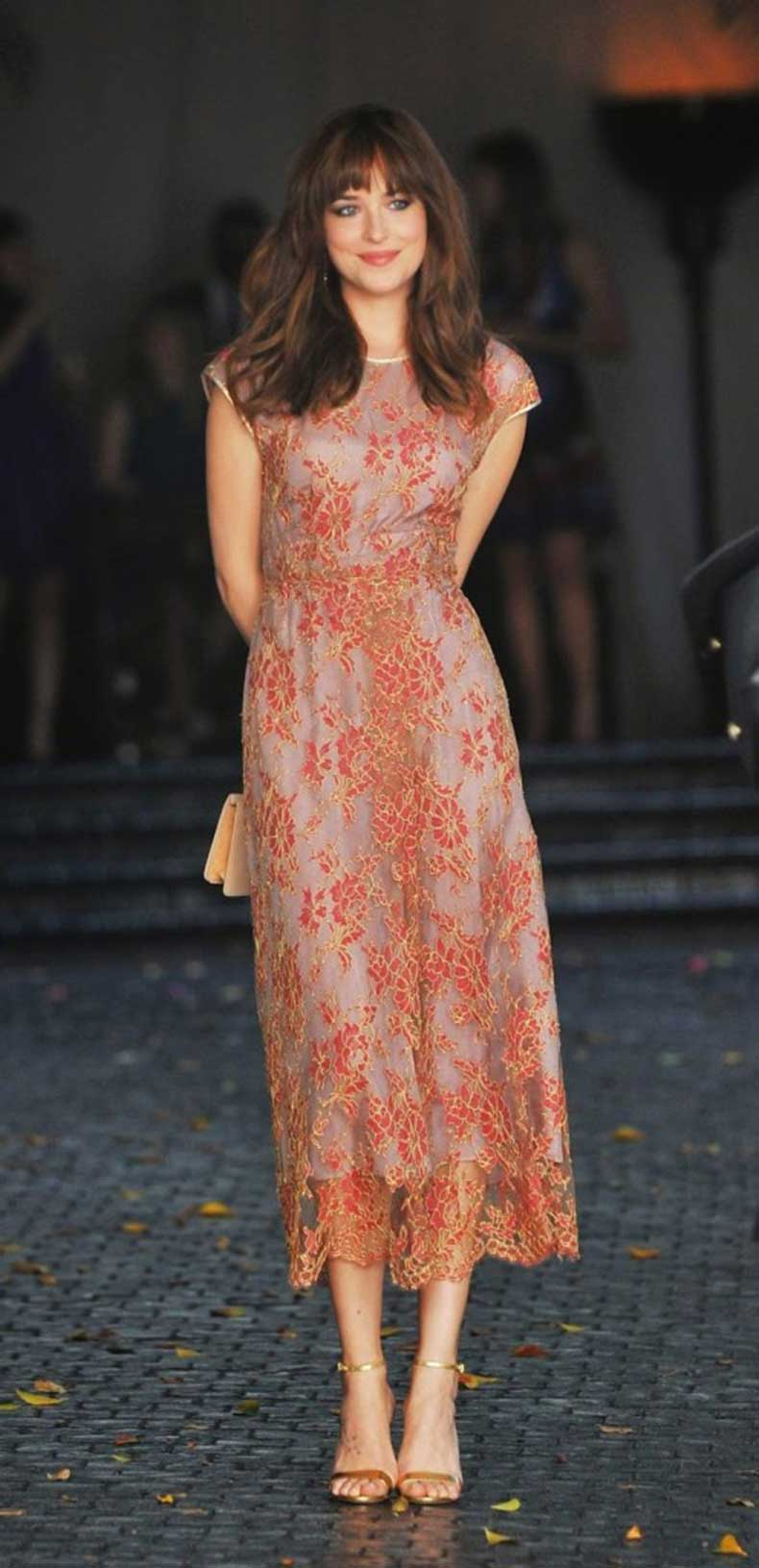 dakota-johnson-pink-lace-dress-gold-sandals-midi-dress-lace-ladylike-spring-via-getty-496x1024