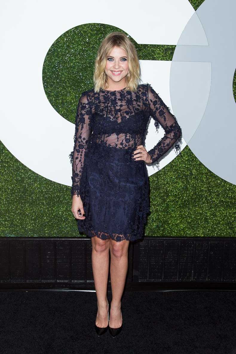 holiday-party-ashley-benson-navy-lace-cocktail-dress-evening-going-out-holiday-party-sheer-see-through-via-popsugar.com_