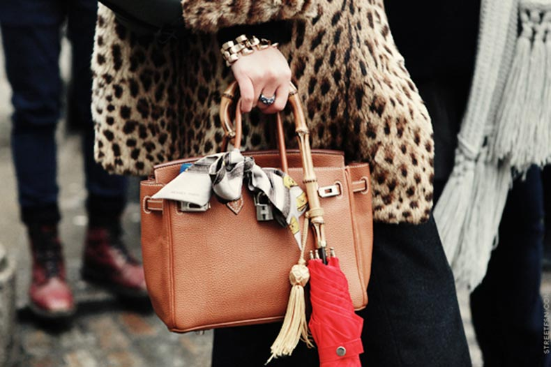 silk-scarf-tied-onto-leather-bag