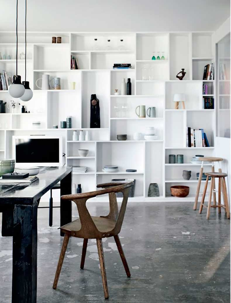 All-White-Bookcase-Wall-with-Ceramics-in-Denmark-Apartment-with-Concrete-Walls,-Remodelista