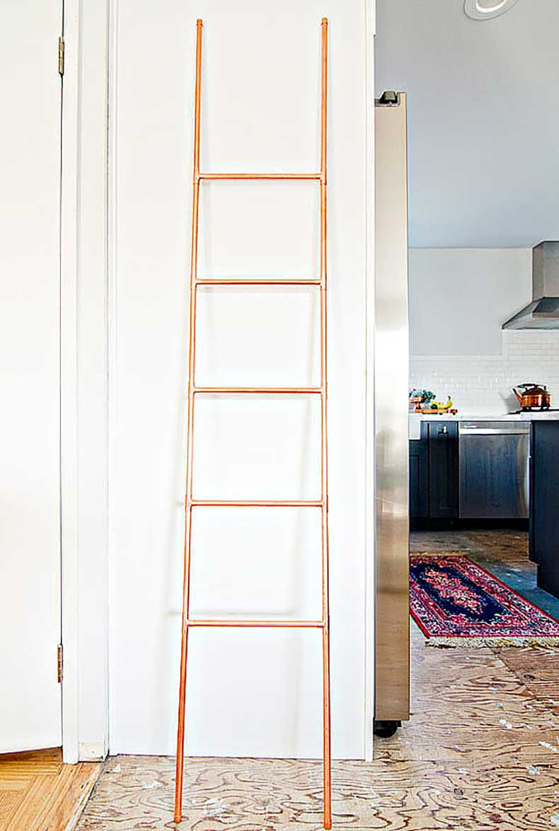 DIY-copper-ladder-perfect-organizing-everything-from