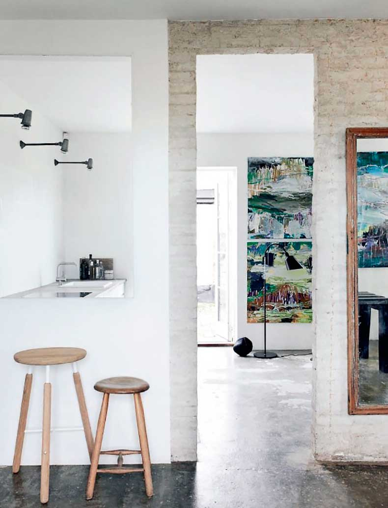 Home-in-Denmark-with-Concrete-Floors-and-White-Painted-Walls-and-Stools,-Remodelista