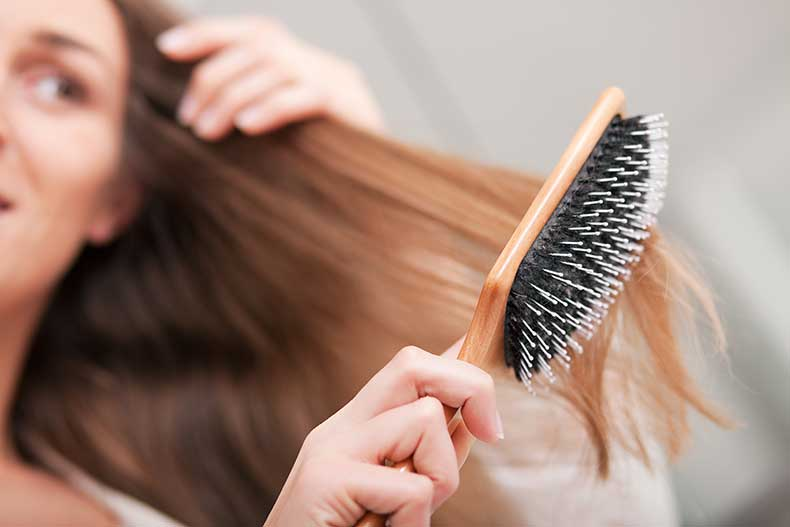 How-To-Straighten-Hair-With-Iron-At-Home-brushing