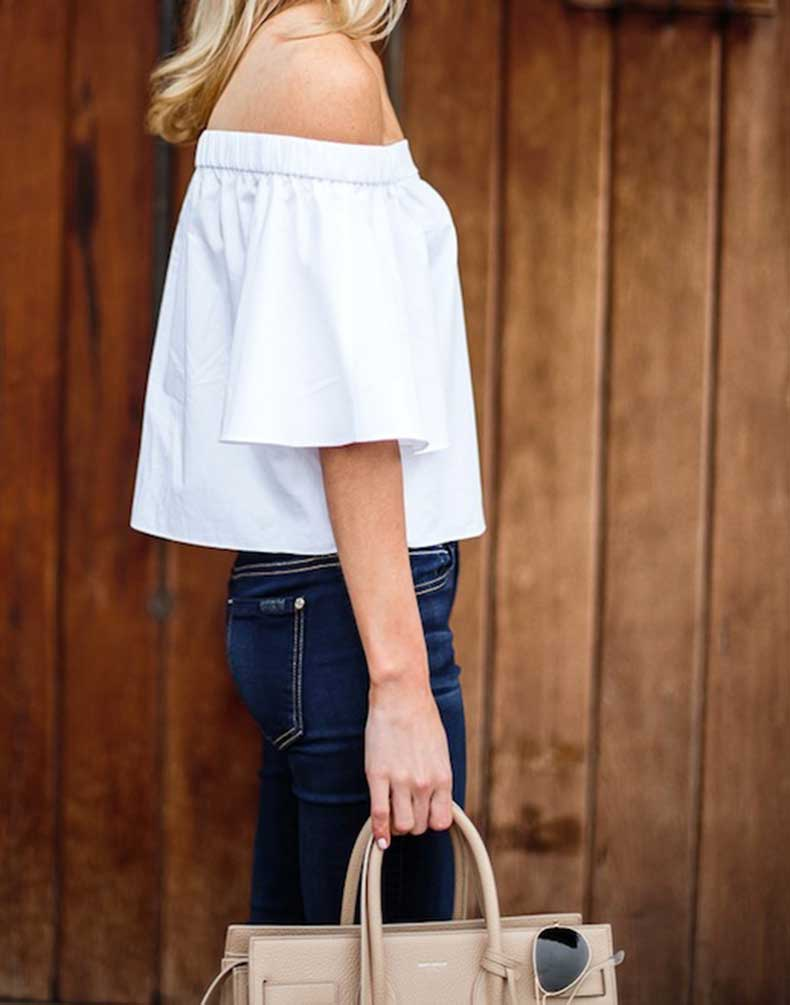 2-Le-Fashion-31-Stylish-Ways-To-Wear-An-Off-The-Shoulder-Look-Blogger-Krystal-Schlegel-Tibi-Top-Nude-Bag-Jeans