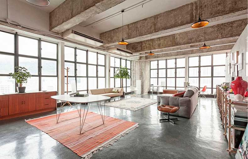 Large-living-space-with-industrial-style-windows-and-Tom-Dixon-pendant-lights