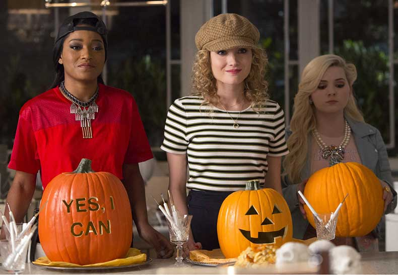 ladies-look-too-cute-carve-pumpkins