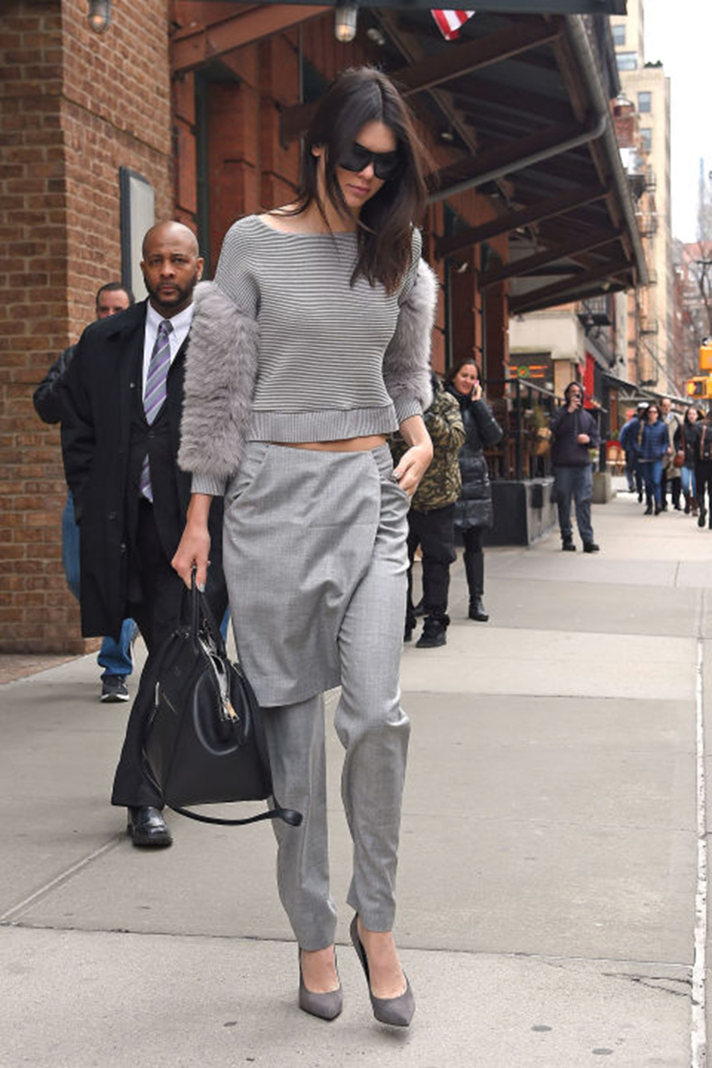 kendall-jenner-grey-all-gray-grey-monochromatic-apron-pants-skirts-over-pants-crop-top-spring-trends-model-style-via-getty