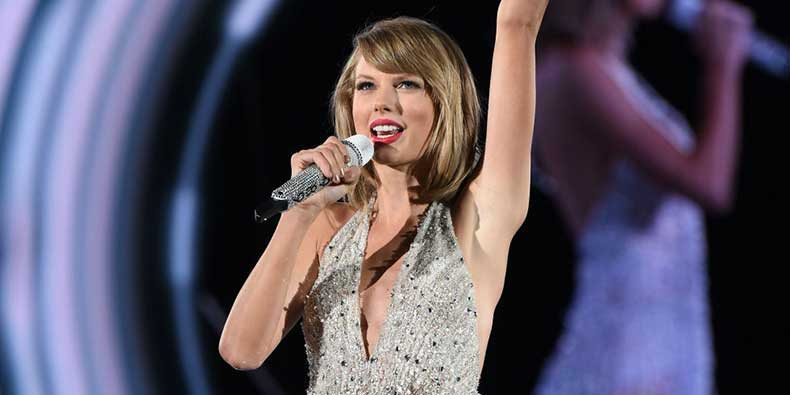 landscape-1438022475-taylor-swift-wearing-a-sparkly-leotard-while-performing-on-stage