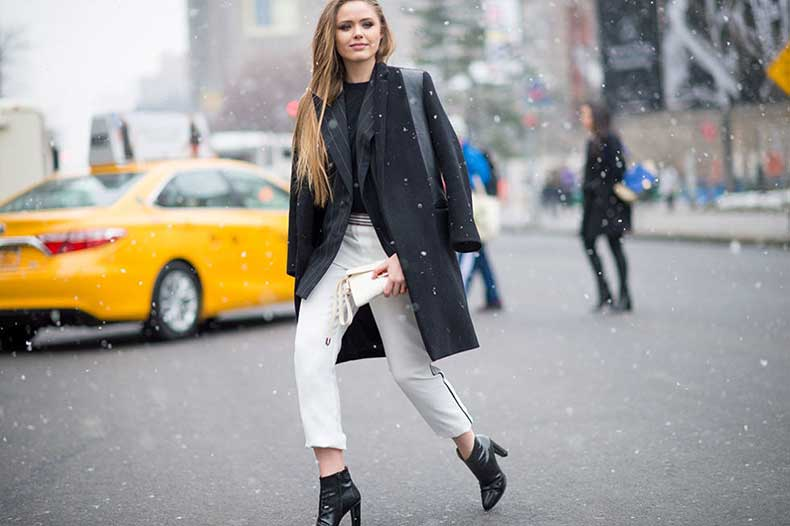 nyfw-winter-layers-freezing-elle-pinstripes-pinstripe-blazer-white-pants-winter-whites-tuxedo-pants-jacket-on-shoulder-black-coat-black-ankle-boots