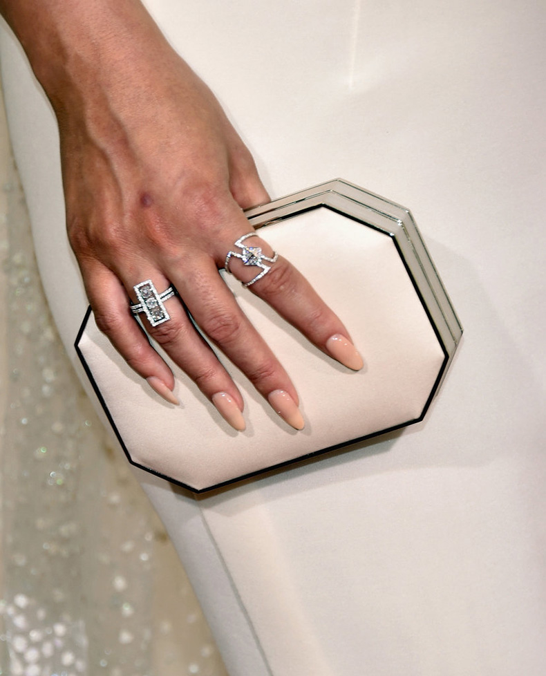 Wearing-Lorraine-Schwartz-rings-carrying-cream-box-clutch
