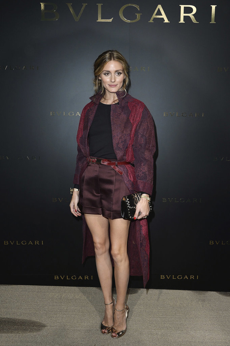belting-her-outerwear-Olivia-ensures-her-coat-stay