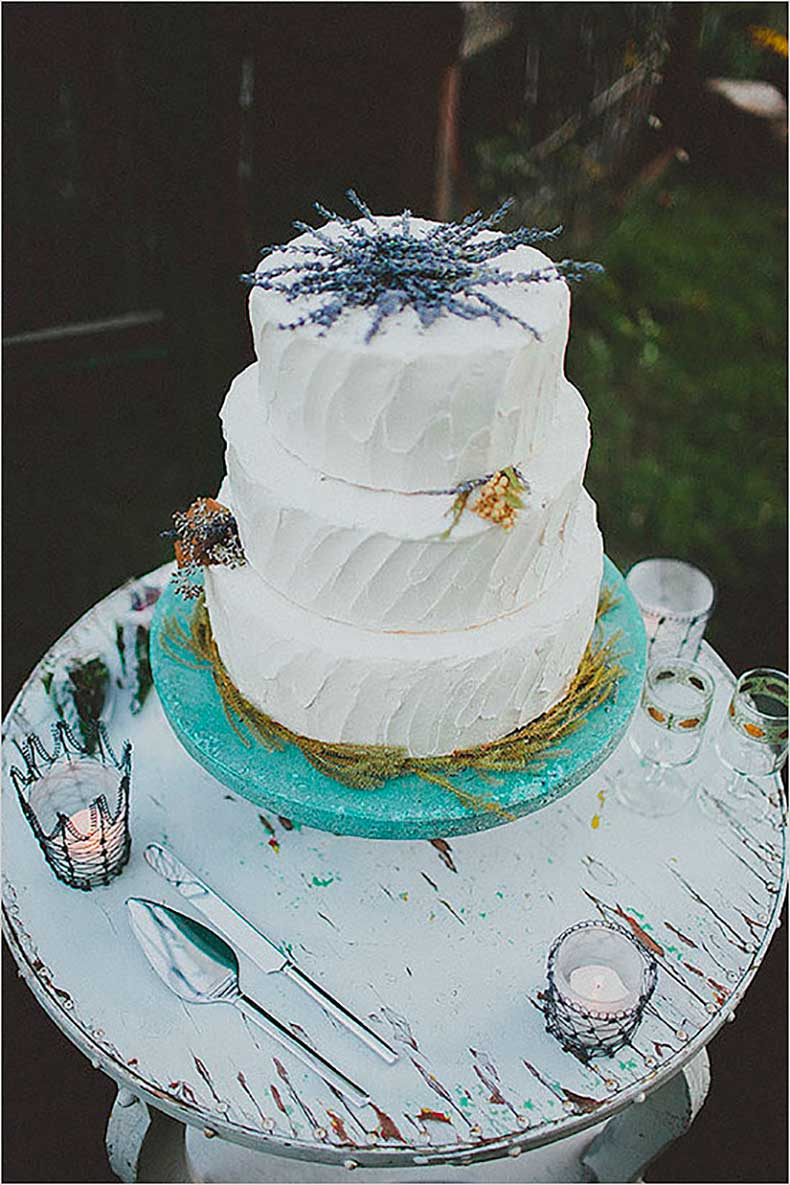 lavender-peeking-out-from-top-charming-white-cake-has