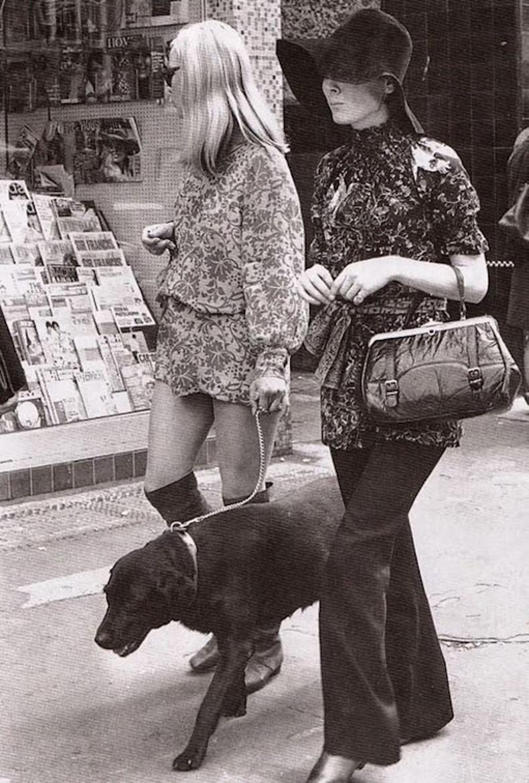 Le-Fashion-Blog-1970s-70s-Street-Style-Vintage-Photos-Print-Romper-Knee-High-Boots-Flared-Wide-Leg-Pants-Floppy-Hat-Via-Tres-Blase