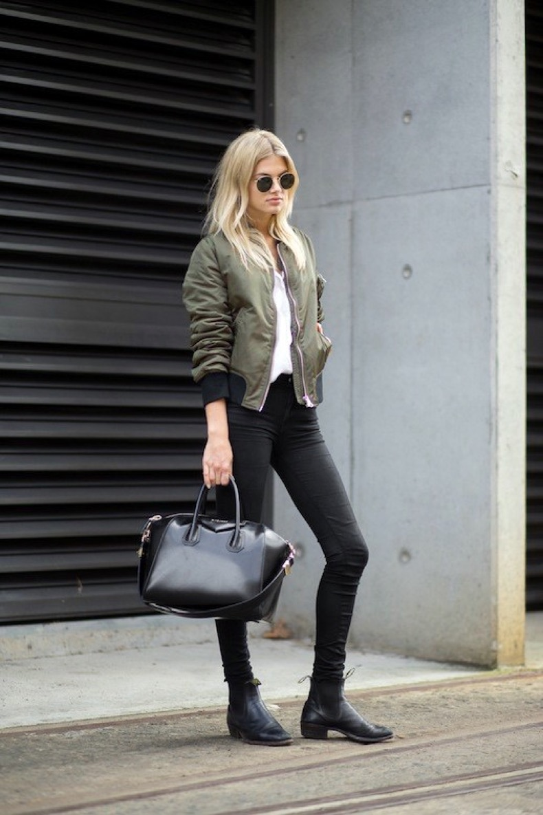 Le-Fashion-Blog-Model-Street-Style-Megan-Irwin-Round-Sunglasses-Green-Bomber-Jacket-Givenchy-Antigona-Bag-Skinny-Jeans-Leather-Boots-Via-Harpers-Bazaar-1